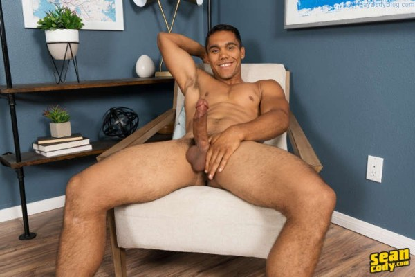 muscled jock sitting back and showing his long hard cock