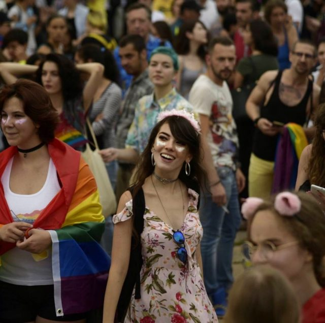 A girl in the crowd at Sofia Pride