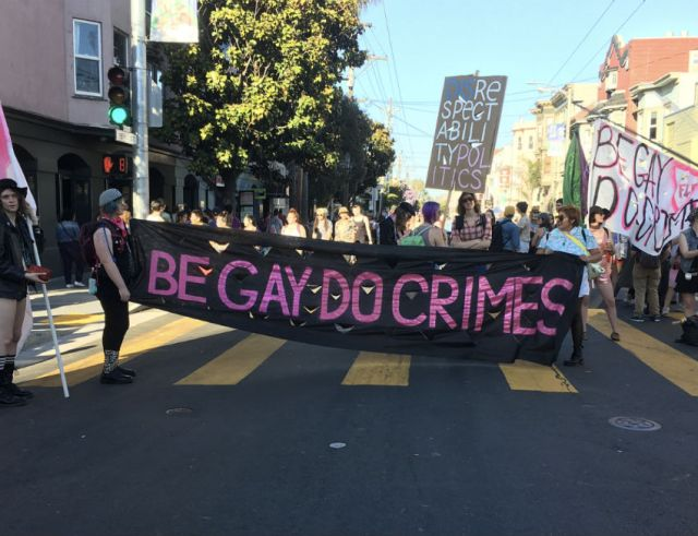 A banner held during the Dyke March in San Francisco in June