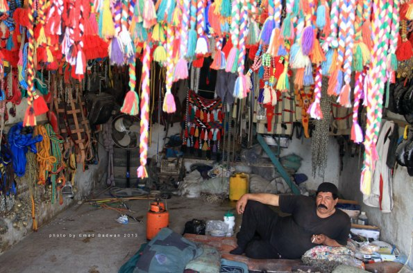 Shopkeeper and his craft work