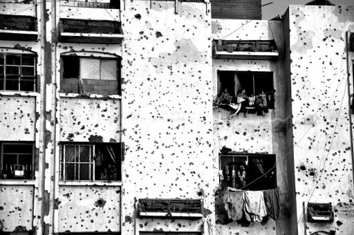 Pockmarked apartment building, families still living in it, 2014 summer war on Gaza