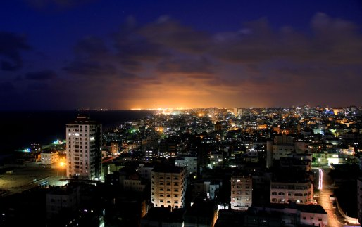Gaza City, 10 PM, the power supply has just returned. The ball of light in the background is in Ashkelon in southern Israel