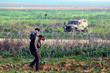 Palestinian slingshot and the Israeli military on the Gaza/Israel border
