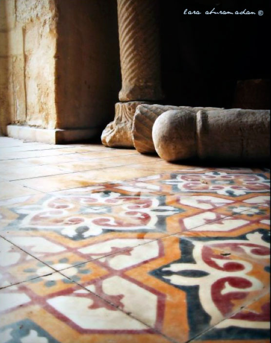Ceramic tiled floor with Roman ruins
