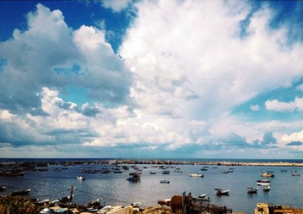 Gaza seaport with big white clouds