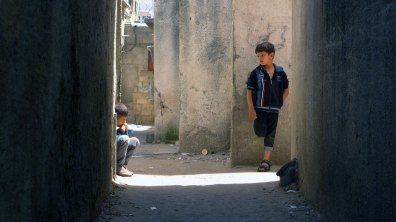 Boys in an alley in Al Shatie refugee camp