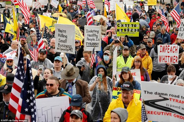 27855212-8275171-Hundreds_of_demonstrators_gathered_at_Michigan_s_state_Capitol_i-a-52_1588292924099-640x426