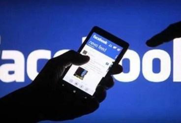Bărbat reţinut de DIICOT după ce şi-a făcut un cont fals pe Facebook