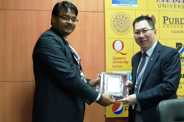 Dr. Leonard Lye, right, is thanked by a representative from Amity University.