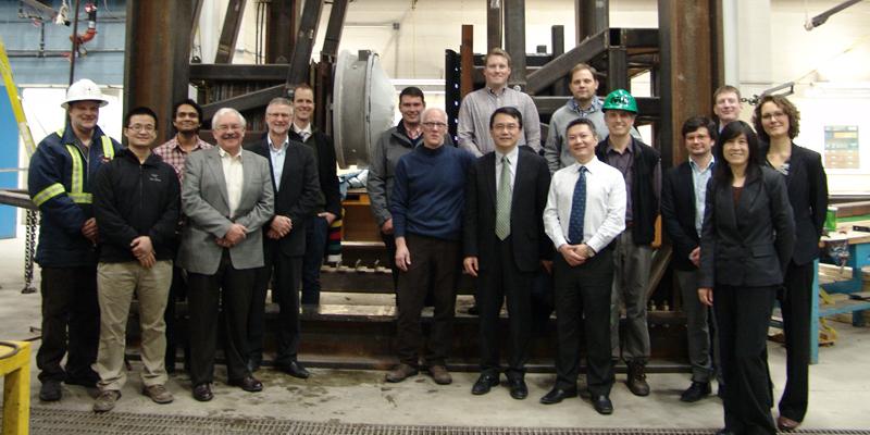 Workshop participants tour the structures laboratory