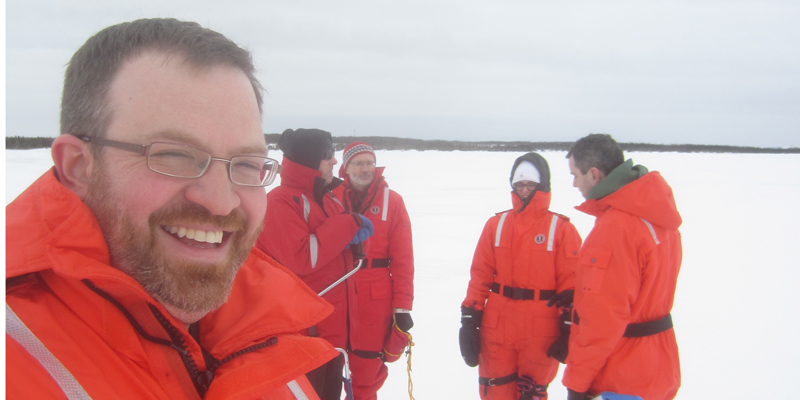 Dr. Taylor takes a selfie with teammates in the background (left to right: Rob Pritchett, Dr. Greg Crocker, Dr. Eleanor Bailey and Dr. Ian Turnbull during a field program on Pistolet Bay, NL in February 2016.