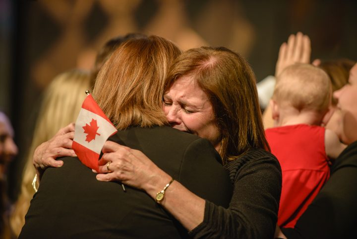 A member of the Enactus Memorial team hugs Prof. Lynn Morrissey.