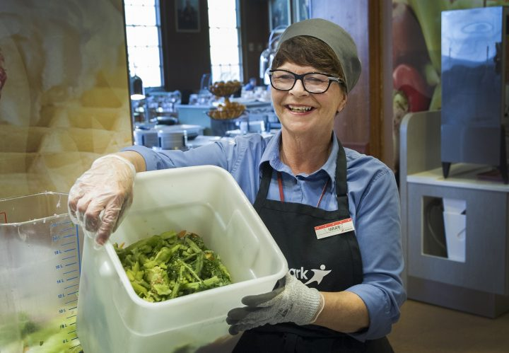 Mary Martin, food service worker at the Main Dining Hall, assists with the composting program.
