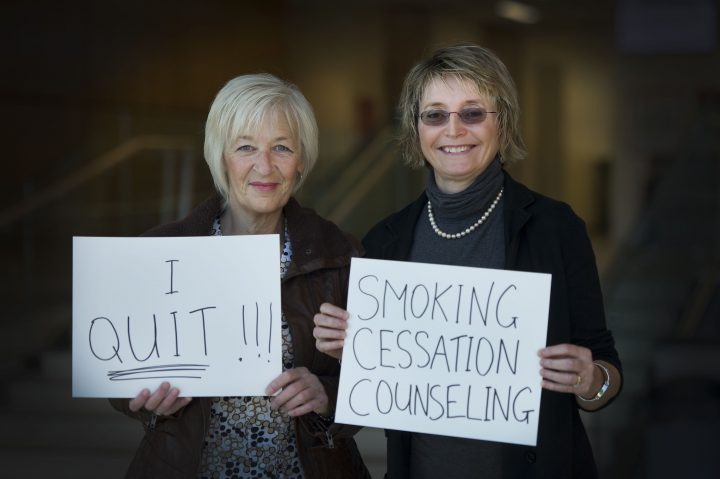 Dr. Leslie Phillips (right) used smoking cessation counselling to help her colleague Karen Brown quit smoking in 2014. Ms. Brown remains a non-smoker.