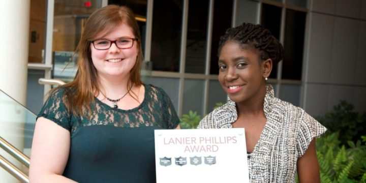 From left, Alex Wicks of the GCSU awards Margarette Leandre the Lanier Phillips Award.