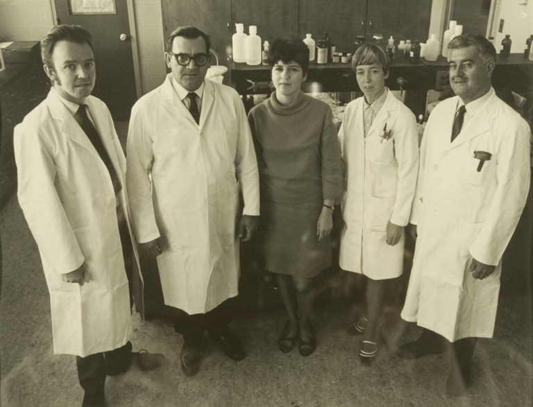 From left are the original five staff members in Biochemistry: Dr. Peter O'Brien, associate professor; Dr. L. A.W. (Woody) Feltham, professor and head; Helen Kennedy, secretary to the head; Veronica Hillier, science assistant; and Munden Bray, science assistant.