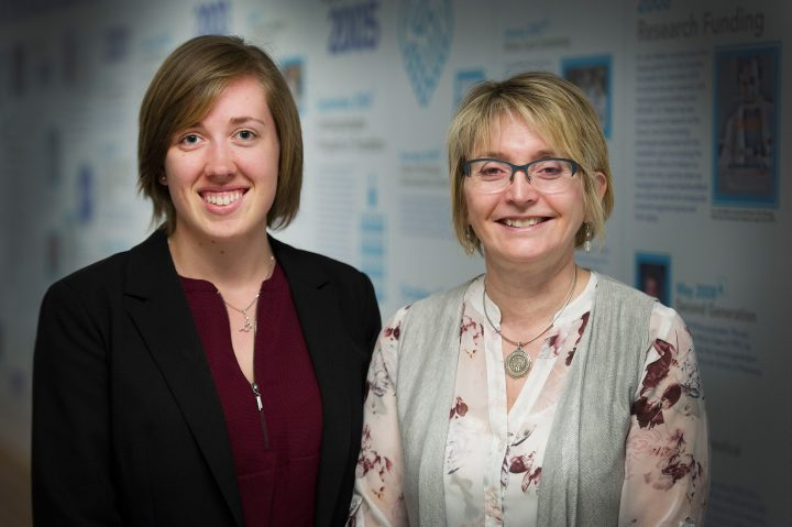 From left are Sydney Saunders and Dr. Leslie Phillips.