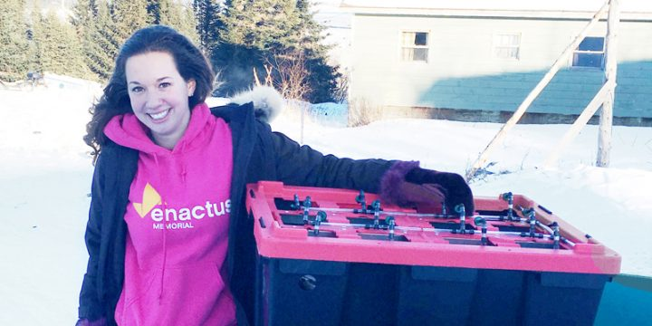 Emily Bland with a Project Sucseed hydroponic unit in Rigolet, Labrador.