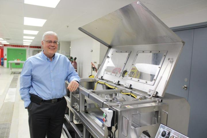 Robert Verge stands beside the sea cucumber eviscerating machine at the Marine Institute.
