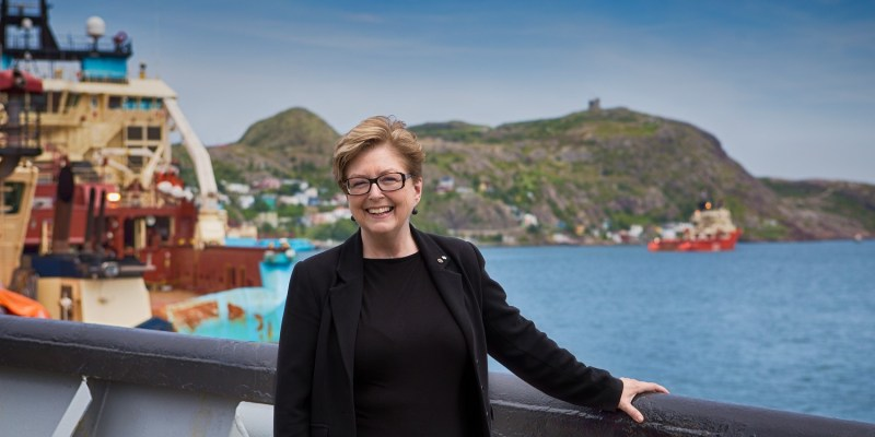 Dr. Knight on board Polar Prince with Signal Hill in background