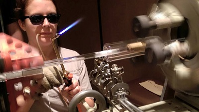 Sabrina Bélanger at the lathe at the 2015 American Scientific Glassblower Society Symposium in Milwaukee, Wis.