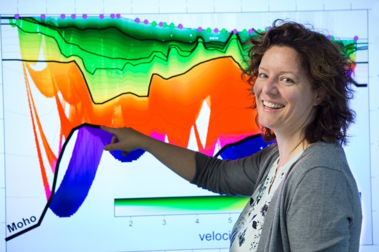 Dr. Kim Welford reviews a model of rock velocities and the geometry of the base of the thinned continental crust beneath Orphan Basin, offshore Newfoundland.