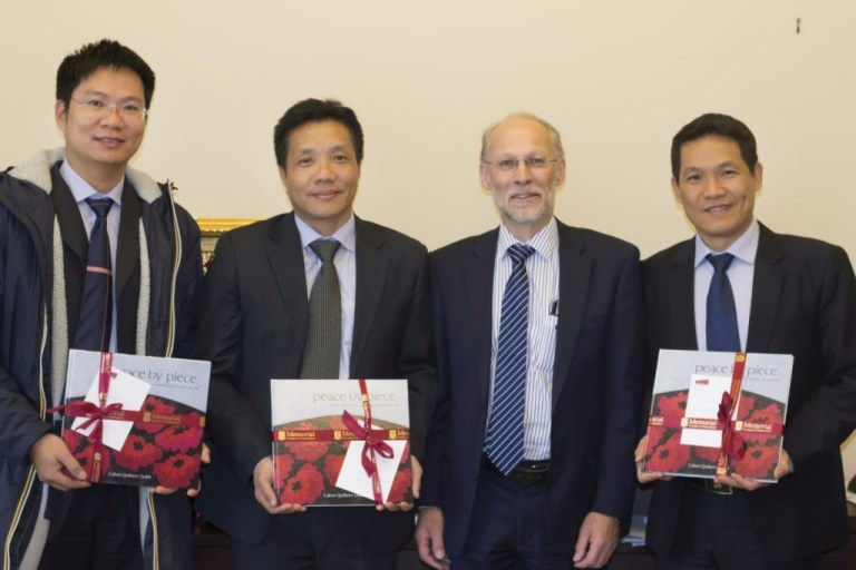 From left: Dr. Ho Trong Long, head, Geology and Geophysics department, PVU; Dr. Le Quoc Phong, head, Academic Affairs Department, PVU; Dr. Neil Bose; and Dr. Phan Minh Quoc Binh, rector, PVU.