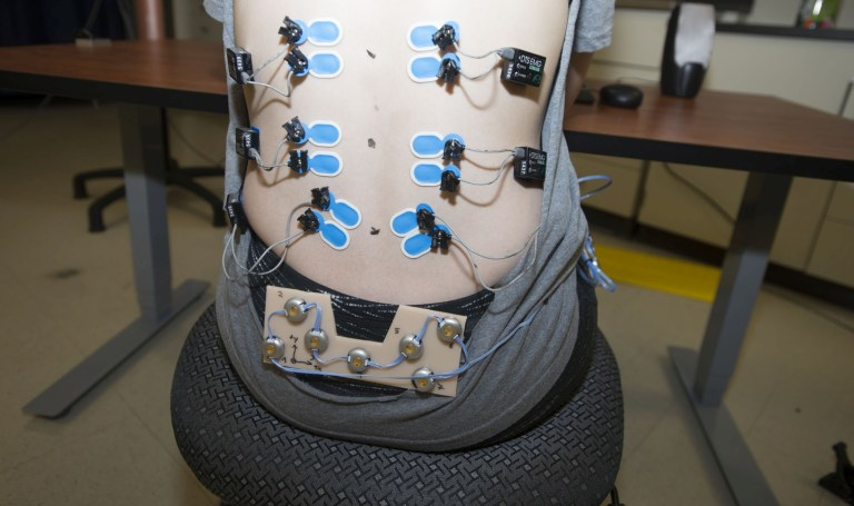 The activity of six low back muscles are monitored wirelessly by the Noraxon DTS Electromyography System.