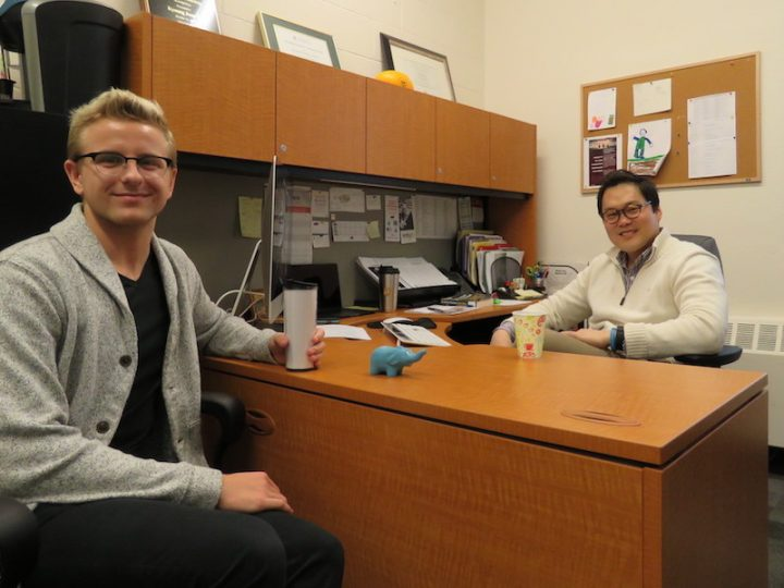 From left, Logan Slade, fourth year B.Kin. student, and Dr. David Yi, professor, share a coffee and conversation in Dr. Yi's office.