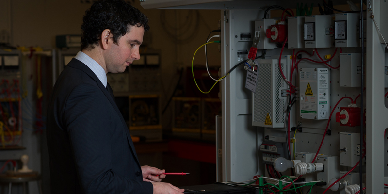 Dr. Kevin Pope working at the Solar/Wind Energy Simulator.