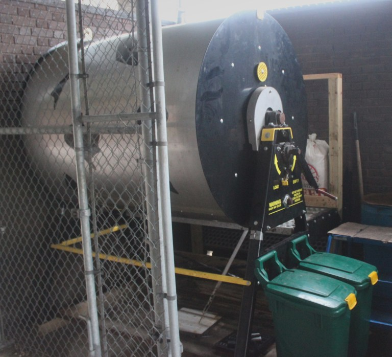 large composter behind bitters
