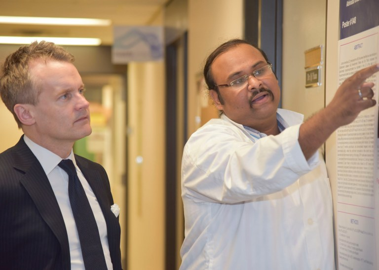 Abhinaba Ghosh, right, a PhD candidate in the Faculty of Medicine spoke with Minister O'Regan on March 12.
