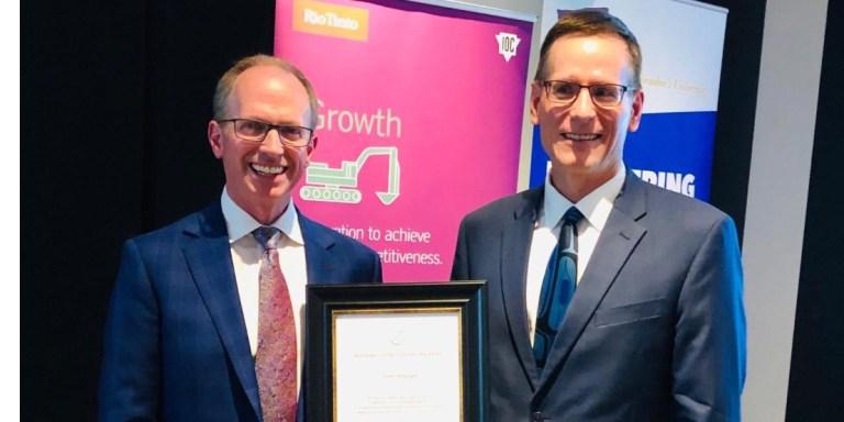 John Whelan (left) receives the 2019 Distinguished Alumni Award from Dr. Greg Naterer at the 50th anniversary celebrations event last summer.
