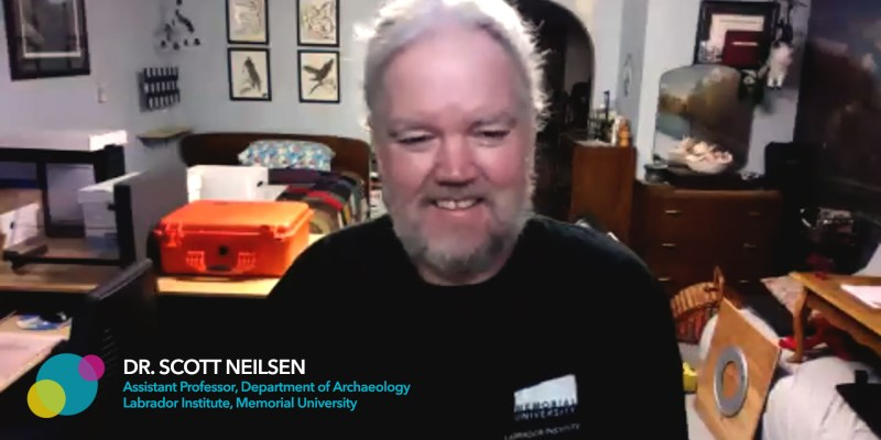 Dr. Scott Neilsen looks at a screen and smiles
