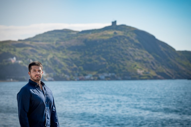 Dr. Gerald Singh stands in front of Signal Hill in St. John's