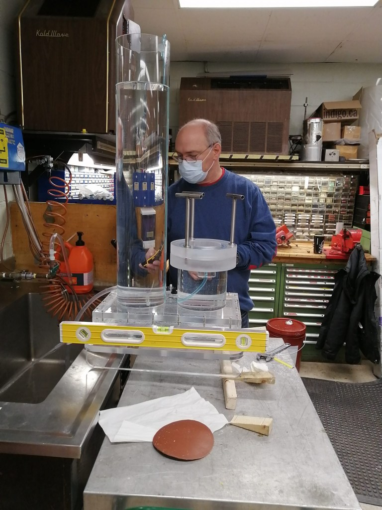 Dennis Cramm performs final check of a hydrostatic pressure test device.