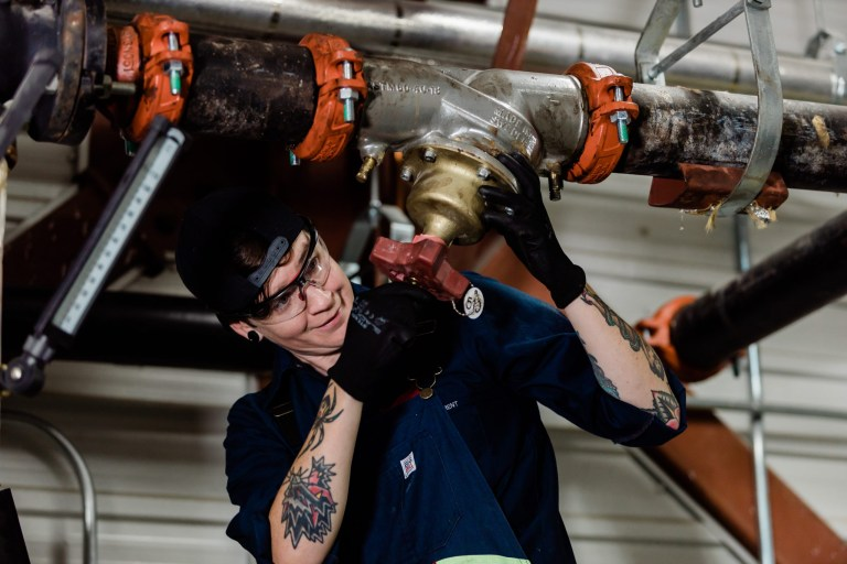 Danielle Browne braces a circuit setter for repair.