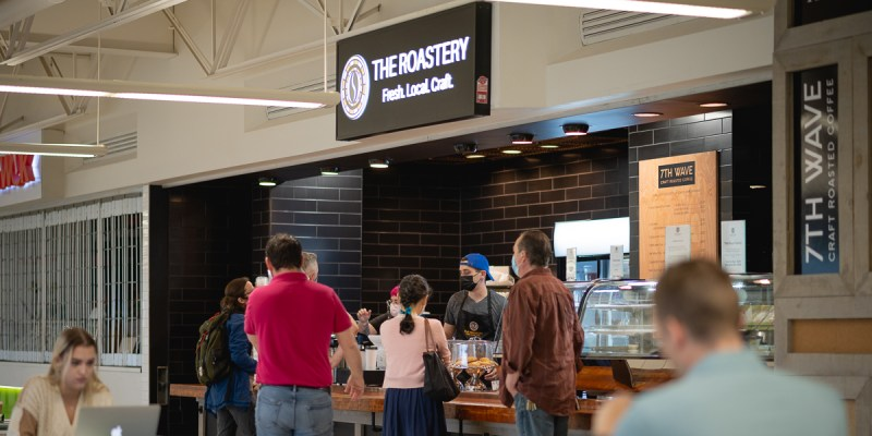 people lined up at The Roastery coffee shop in the university centre.