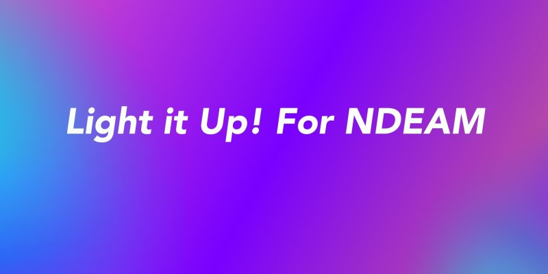 """The words """"Light it Up! For NDEAM"""" are in white on a blue and purple background"""