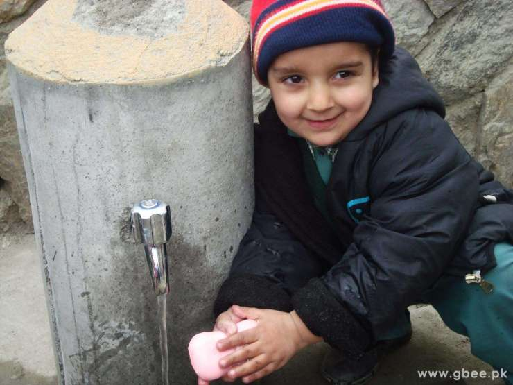 A Hunza kid washing hands
