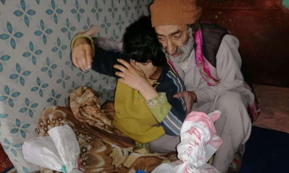 A man in Gilgit-Baltistan with his young disabled family member