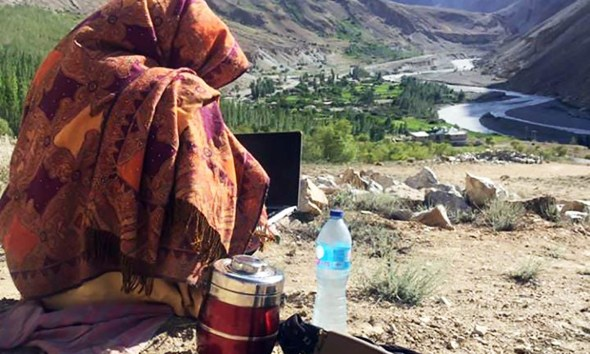 A girl takes online classes Gilgit-Baltistan miles away from home due to bad internet connectivity.
