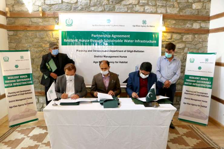 Mr. Nawab Ali Khan, CEO, AKAH, P and Mr. Syed Abrar Hussain Shah, Additional Chief Secretary Gilgit-Baltistan and Mr. Fayaz Ahmed, Deputy Commissioner Hunza, are signing the partnership agreement to conduct a feasibility study to design a water project for central Hunza.