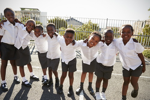 Elementary school kids in Africa posing in school playground