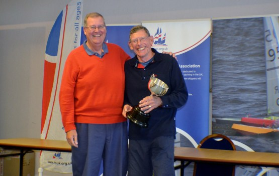 Tony Edwards holds the Trophy presented to him by Keith Coxon MYA Chairman - image by Sue Brown
