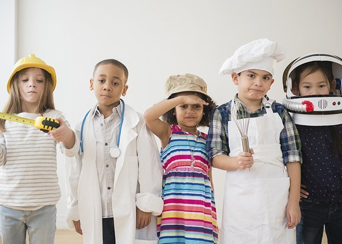 Children playing dress up together