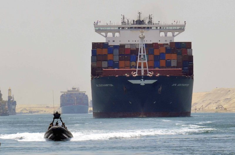 A cargo ship is seen crossing through the New Suez Canal in a 'test run' held July 25, 2015. REUTERS/Stringer