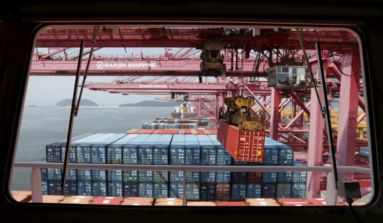 File photo of a crane carrying a container from a ship of Hanjin Shipping at Hanjin container terminal at the Busan New Port in Busan