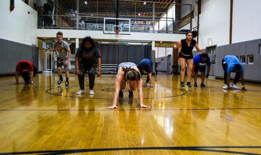 Burpees across the gym.