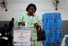 A woman casts her vote at a polling unit during the presidential election in Cameroon's capital Yaounde October 9, 2011.